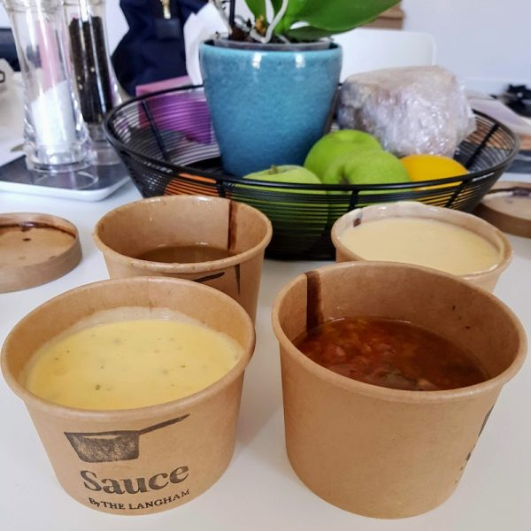 Cooking Lessons in London Sauce at the Langham DoinDubai take home sauces in containers